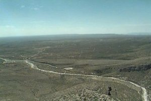 <b>Looking South</b><br> View from the top looking deep into Texas. White channel is a creekbed in which erosion has exposed the old reef from the time when this was the Permian Sea