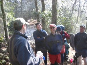 """<b>Trail Break</b><br> We took a lunch break at the Rough Creek trail junction. just before we hit the snow zone around 4400'. The next few miles were much tougher with 6-8"""" of snow and ice on the trail."""