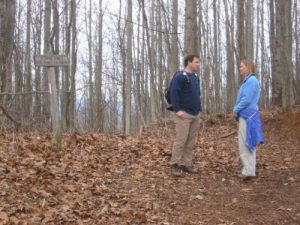 <b>Trail Junction</b><br> At the ridge crest, there is a wood sign and a junction with a trail leading 2.5 miles to Forest Road 711. Here you will turn left and hike back towards Deep Gap for roughly a mile. (Going straight at the ridge crest will take you down to Blue Ridge Lake which requires a car shuttle.)