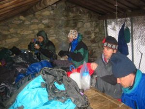 <b>Laurel Gap Shelter (5600')</b><br> The snow began to fall before sunset after we hiked an hour in the rain. Here we are drying out at Laurel Gap Shelter.