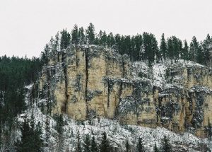<b>Surrounding Cliffs</b><br> Here is just one of the surrounding limestone cliffs visible from the trail.