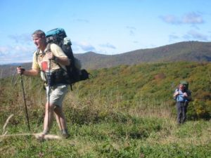 <b>Almost There</b><br> Black Crowe and The Camel hike the last few steps up Siler.