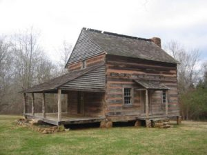 <b>Billy Graham's Grandfather's Cabin</b><br> Although it was originally located a few miles from here, the cabin was moved to Anne Springs Close Greenway and is currenly on display in this meadow.