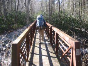 <b>Bridge Over The Little River</b><br> Brady walks across a bridge over the Little River. Things would get much tougher when we hit the Goshen Prong Trail.
