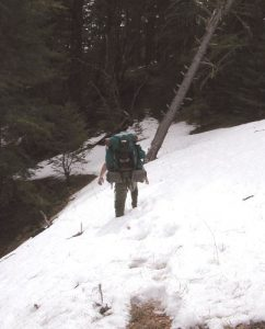 <b>Headign Out</b><br> In March, expect to find snow over 8,500 feet. Here Mike leads out through one of the covered trail sections. We found spots on the trail as deep as 3 feet.
