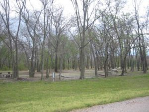 <b>The Campground</b><br> At Bicentennial State Park, visitors will find two separate camping areas with a total of 21 picnic tables, 2 group picnic shelters, 2 comfort stations (1 with showers), a playground, one lighted and one unlighted canoe ramp, and 38 primitive campsites for tent camping.