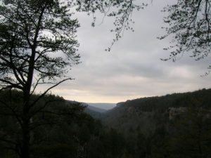 <b>View From Rattlesnake Point</b><br> We reached Rattlesnake Point about an hour before sunset with clouds still hovering over the ravine. By dusk, the sun started to penetrate the cloud cover, and we had stars throughout the night once the cold front pushed into the area.