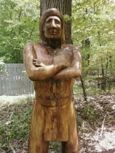 <b>The Indian</b><br> This wood carving of an Indian is located at the end of the trail next to the museum.